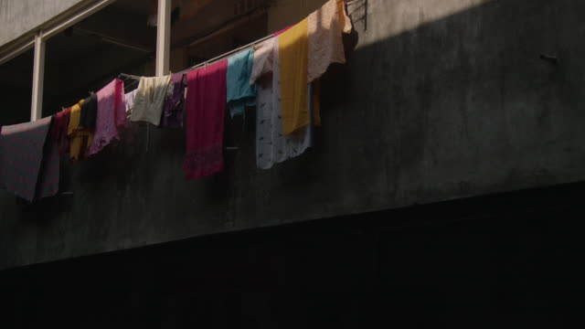 Clothes hung with pegs dry on a washing line Mumbai India FKAD675A Clip taken from programme rushes ABQA810K