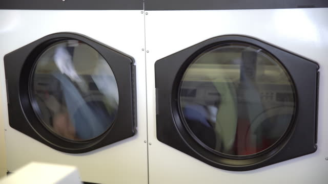 ms clothes in the dryer - launderette stock videos and b-roll footage