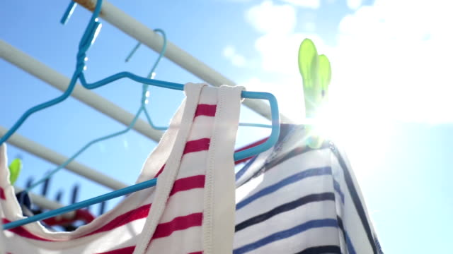clothes laundry hanging on the clothesline in the sun. - washing line stock videos & royalty-free footage