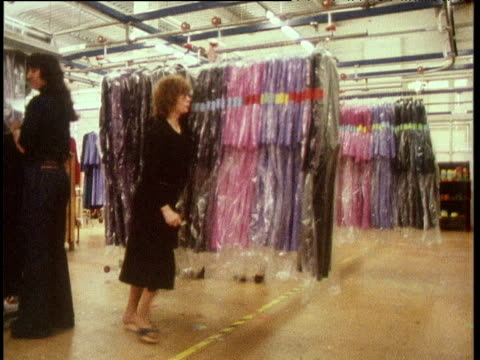 clothes loaded and transported along rail in factory london; 1970's - human hair stock videos & royalty-free footage