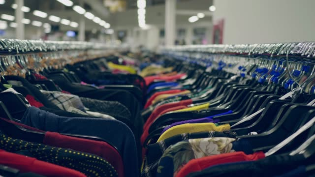 clothes on a coat rack - department store stock videos & royalty-free footage