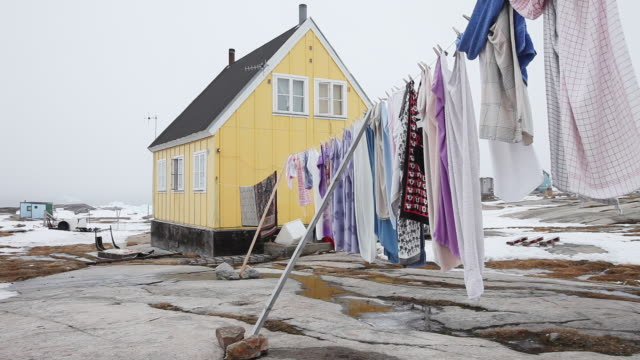 stockvideo's en b-roll-footage met clothesline blows in wind, greenland - wasknijper