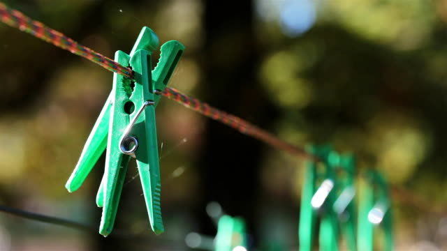 clothespins hang on a clothesline. - clothes peg stock videos & royalty-free footage