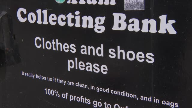 clothing bank recycling bins; england: london: ext gvs of clothing bank collection bins with signs 'recycling', 'oxfam', thank you', 'shoes' /... - clothing stock videos & royalty-free footage