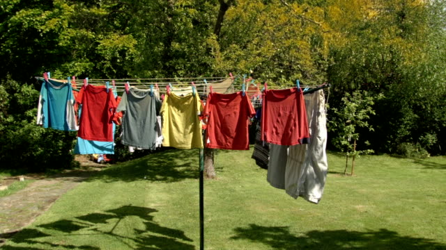 hd: clothing blowing on a washing line - washing line stock videos & royalty-free footage