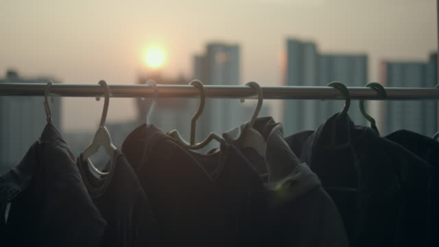 clothing drying in the wind on sunset - shirt stock videos & royalty-free footage