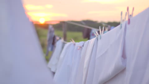 clothing drying in the wind on sunset - washing stock videos & royalty-free footage
