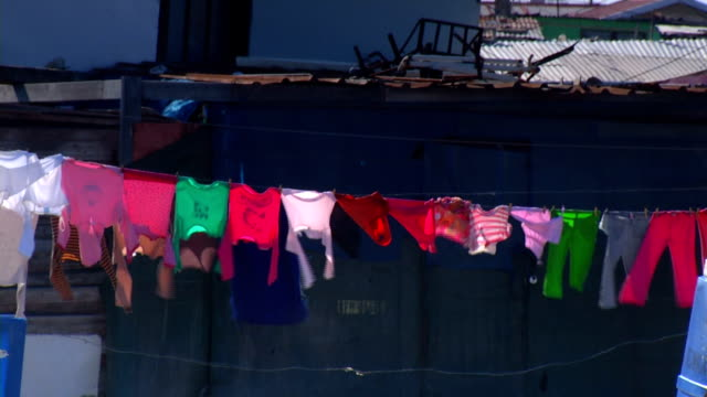 clothing drying on washing line/ diepsloot/ south africa - drying stock videos and b-roll footage