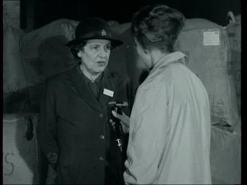 lady hillingdon interview england london royal albert docks ext ms bundles hoisted aboard 2 shot interview lady hillingdon sof they have made a... - hoisting stock videos & royalty-free footage