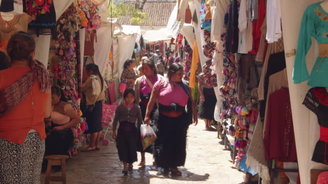clothing stalls in a traditional market in downtown san cristobal de las casas, chiapas, mexico - narrow stock videos & royalty-free footage