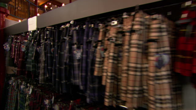 a clothing store displays tartans and kilts in edinburgh. - kilt stock videos & royalty-free footage