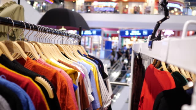 clothing store in shopping mall - coathanger stock videos & royalty-free footage
