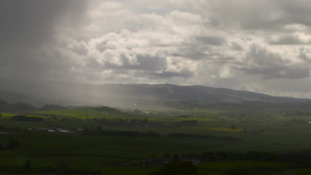 cloud and rain over farmland and hills, scotland - horizontal stock videos & royalty-free footage
