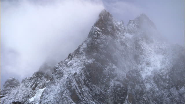 Cloud billows over snowy mountain peak, Mount Kenya, Kenya