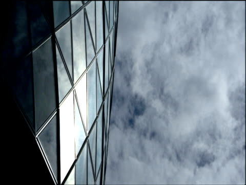 Cloud drifts over 30 St Mary Axe (also known as 'The Gherkin') London