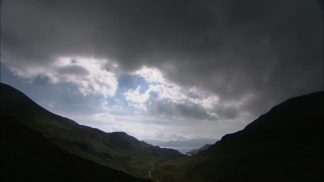 cloud drifts over mountains and coast, aleutian islands, alaska, usa  - aleutian islands stock videos and b-roll footage