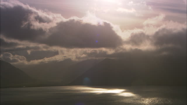 cloud drifts over mountains and coast at sunset, aleutian islands, alaska, usa  - aleutian islands stock videos and b-roll footage