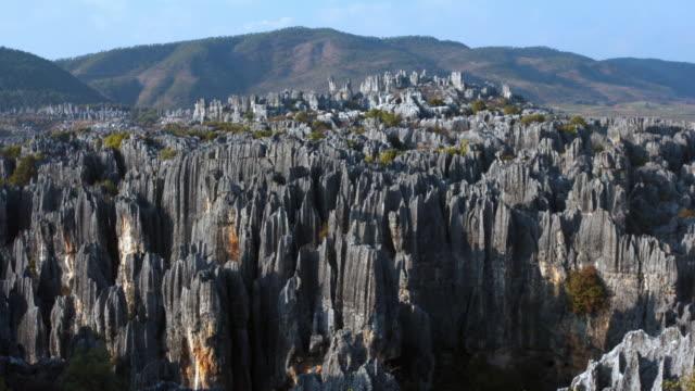 Cloud drifts over Shilin stone forest, Yunnan, China