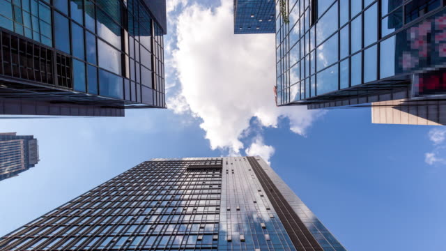 cloud movement in office buildings - tilt stock videos and b-roll footage