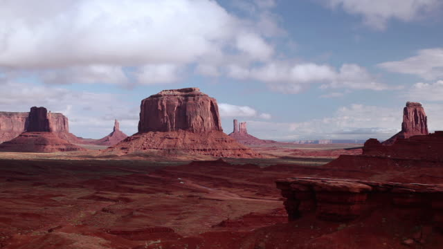 t/l cloud movement over the scenic red rocks of monument valley / kayenta, arizona, united states - mesa stock videos and b-roll footage