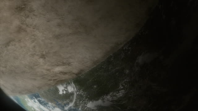 vídeos y material grabado en eventos de stock de a cloud of dust and debris covers the earth in a computer generated animation. - escombros