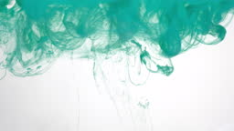 Cloud of mint green watercolor ink in water on white background. Beautiful abstract background.