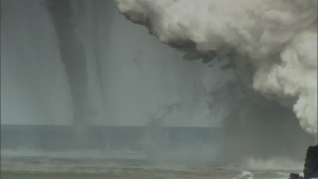 a cloud of volcanic ash forms a waterspout. - blowhole stock videos & royalty-free footage