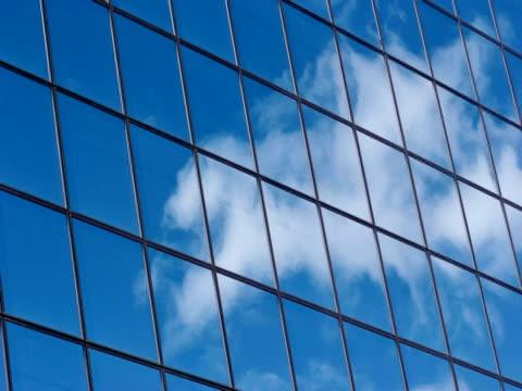 t/l cloud reflected in windows on modern building, low angle, anchorage, alaska, usa - 足根点の映像素材/bロール