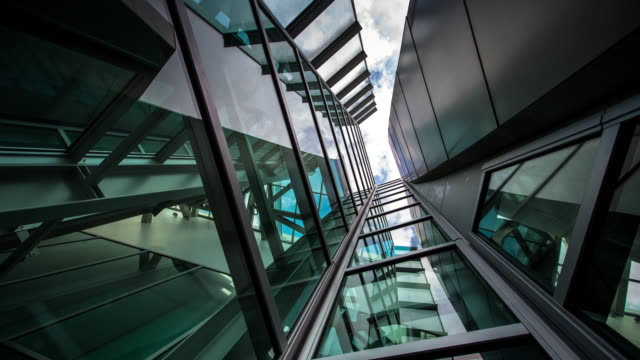 cloud reflections above narrow glass and steel shaft - time lapse - architecture stock videos & royalty-free footage