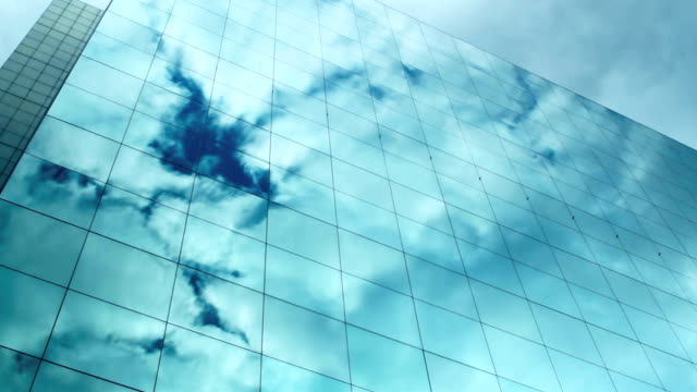 t/l cloud reflections on skyscraper windows - low angle view stock videos & royalty-free footage