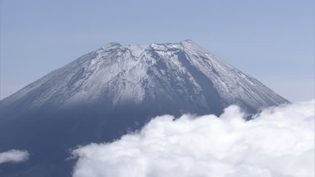 aerial, cloud sea and mt fuji with first snowcap, shizuoka, japan - occurrence stock videos & royalty-free footage