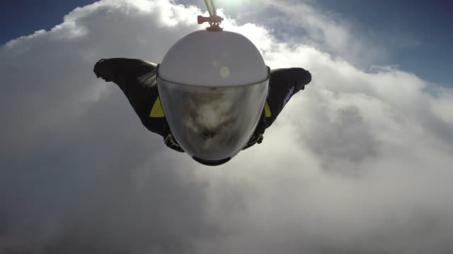 Cloud Surfing In A Wingsuit