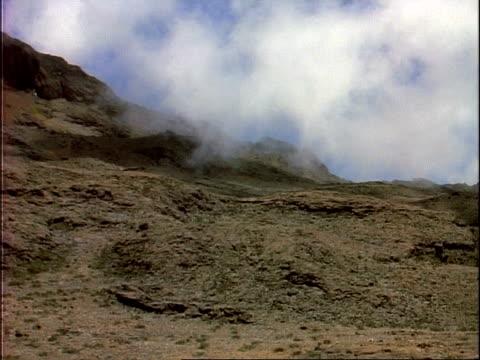 ms cloud swirling across barren landscape of mount kilimanjaro, tanzania, africa - dry stock-videos und b-roll-filmmaterial