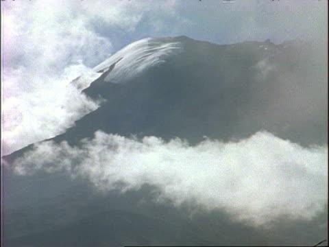 MS Cloud swirling across snowy ridge of Mount Kilimanjaro, Tanzania, Africa