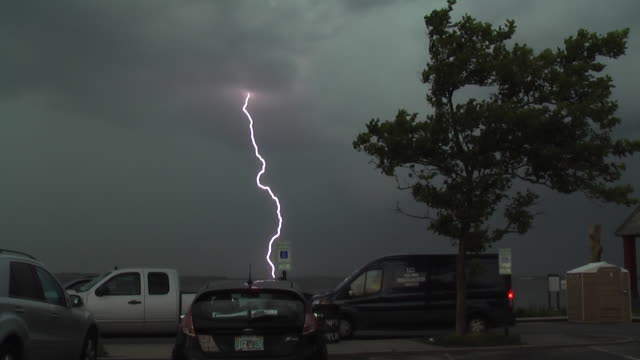 cloud to ground lightning strikes the waters of jamaica bay during a severe thunderstorm in howard beach queens new york new york - scott mcpartland stock videos & royalty-free footage