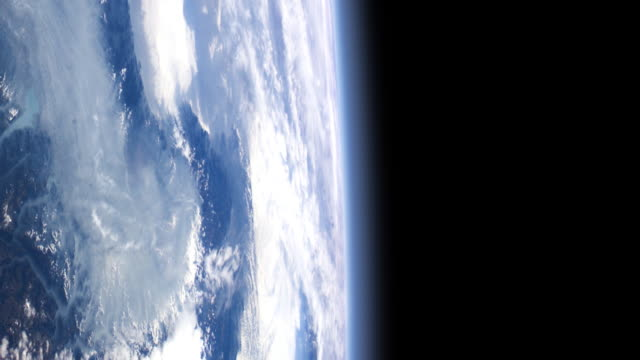 Cloud-covered earth as if seen from an orbiting satellite