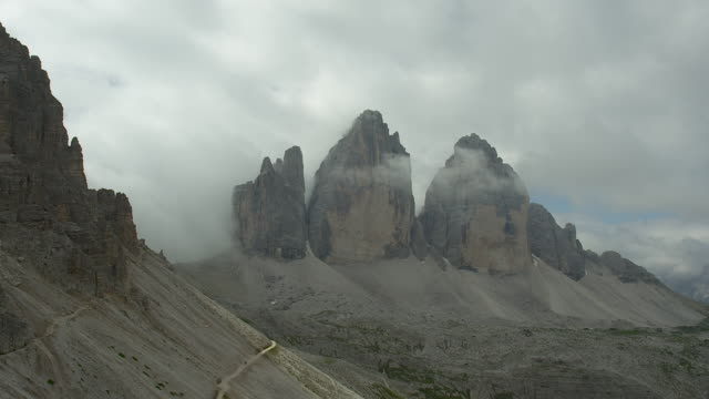cloud-covered sky over the three peaks - tre cimo di lavaredo stock videos & royalty-free footage