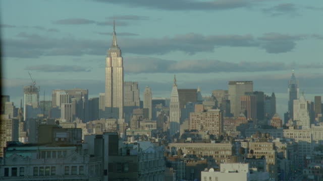 clouds above manhattan skyline with empire state building in late afternoon / new york city - 1998 stock videos & royalty-free footage