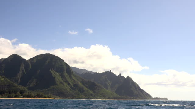 clouds above massive kauai island mountains - butte rocky outcrop stock videos & royalty-free footage