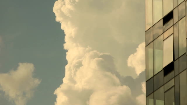 clouds and building in long island city queens - thick stock videos and b-roll footage