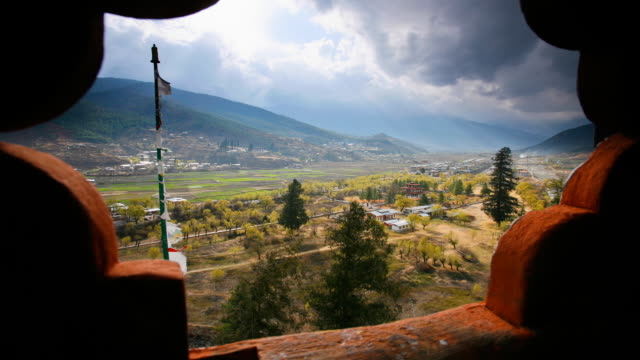 t/l, ws, clouds and light passing over valley framed through window of paro dzong / paro, bhutan - bhutan stock videos & royalty-free footage