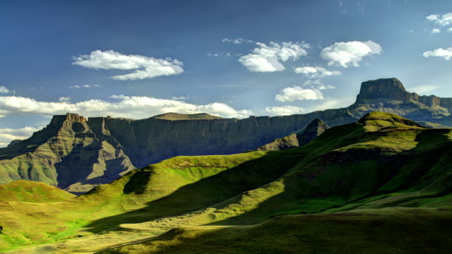 clouds and shadows moving across the amphitheatre - drakensberg mountain range stock videos & royalty-free footage