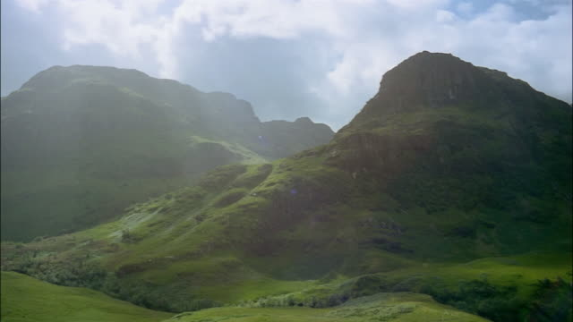 clouds and shadows pass over the three sisters mountains. - scotland stock videos & royalty-free footage