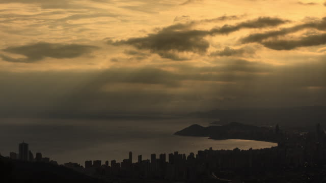 clouds and sun in the coast of benidorm - time lapse - vacancyサイン点の映像素材/bロール