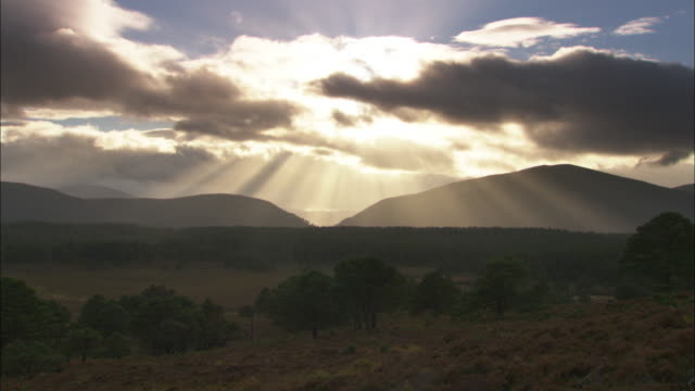 Clouds and sunbeams over Autumnal hills, Scotland, UK