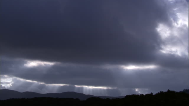 Clouds and sunbeams over mountains, Aberdare, Kenya