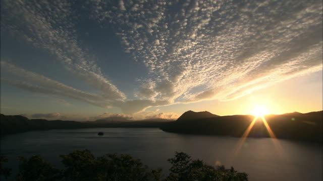 clouds and sunrise at lake mashu in early autumn in hokkaido - hokkaido stock videos & royalty-free footage