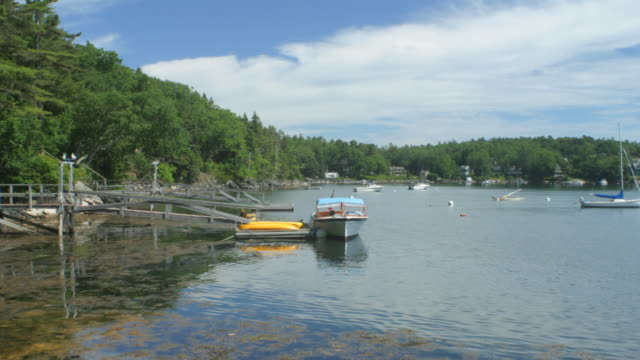 WA T/L clouds and tide, boats moving with tide, Maine, USA