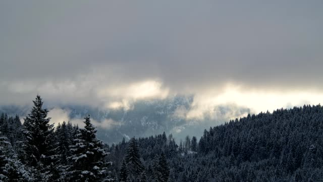clouds are moving in front of karwendel mountains on morning in winter, gerold, garmisch-partenkirchen upper bavaria, bavaria, germany, european alps - werdenfelser land stock videos and b-roll footage