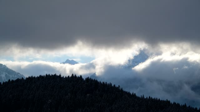 clouds are moving in front of karwendel mountains on morning in winter, gerold, garmisch-partenkirchen upper bavaria, bavaria, germany, european alps - karwendel mountains stock videos and b-roll footage